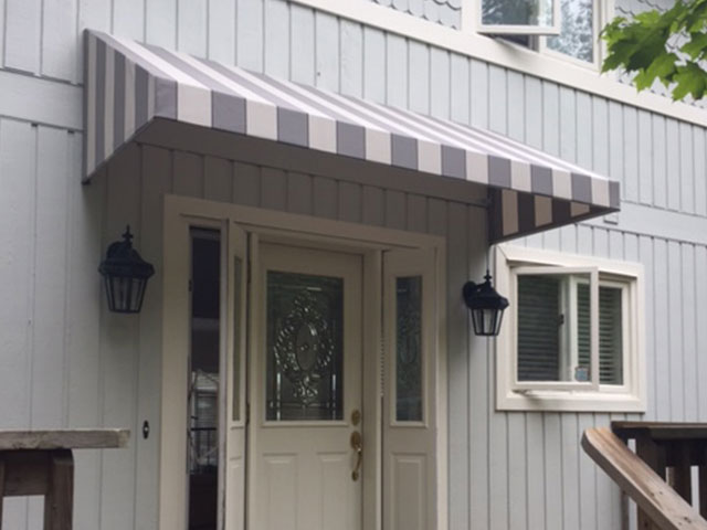 striped awning over doorway